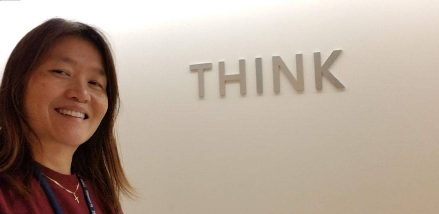 Mary in front of IBM's THINK logo